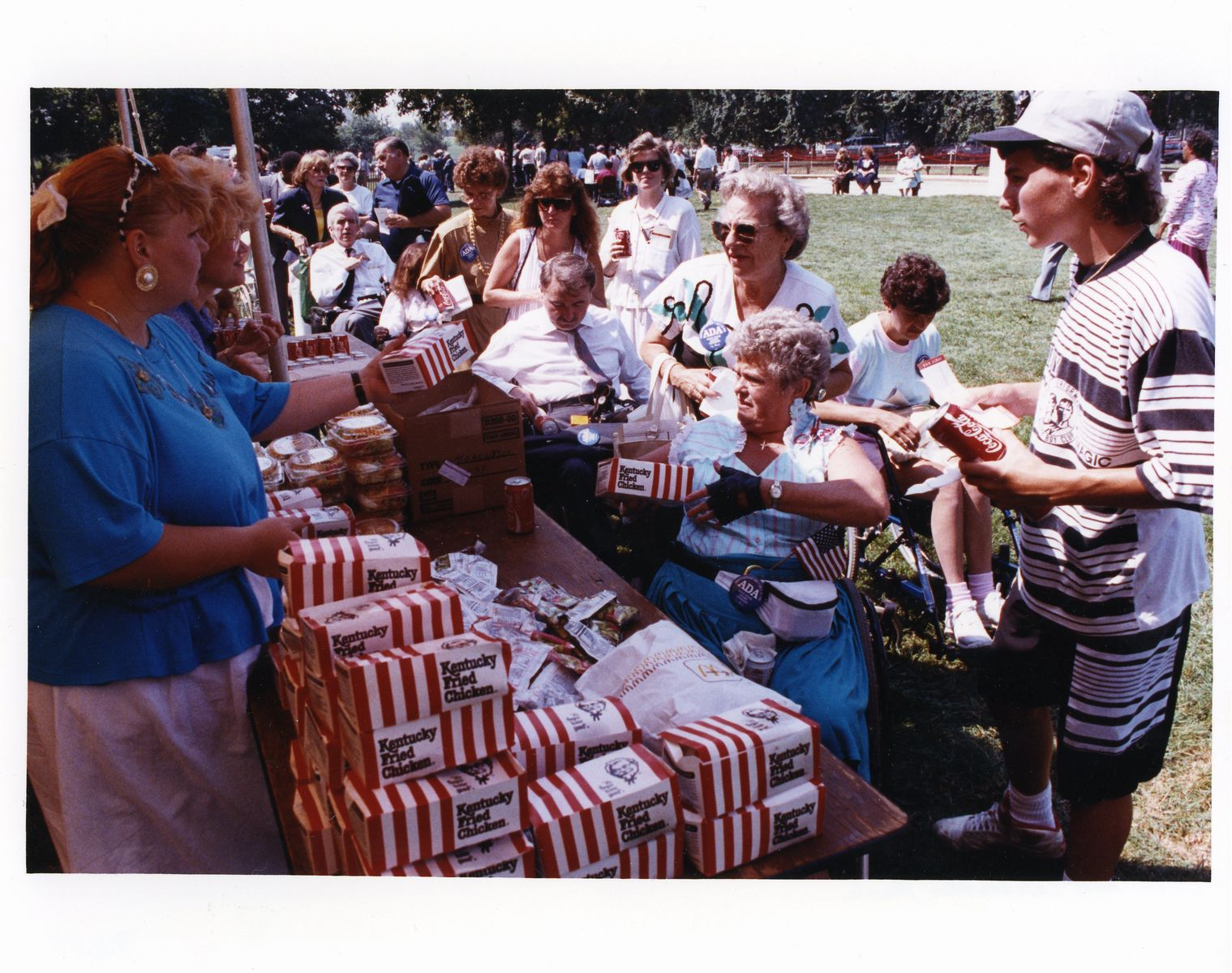 Monica Hall, ECNV staff, handing out lunch boxes to people at the picnic